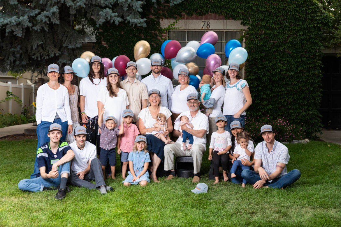 The family with balloons and hats