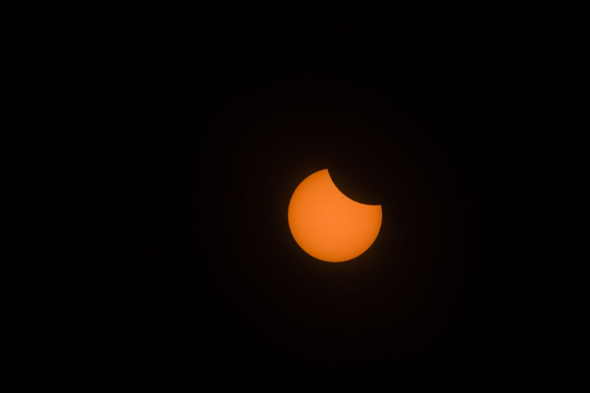The eclipse begins