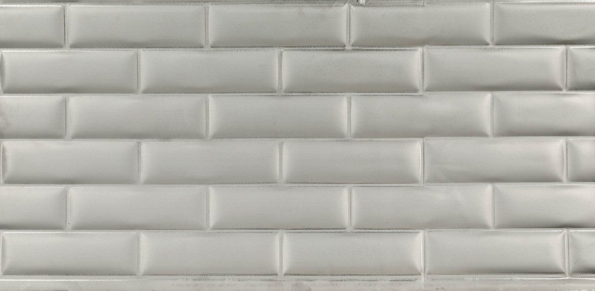 Showing detail in the aluminum subway tiles