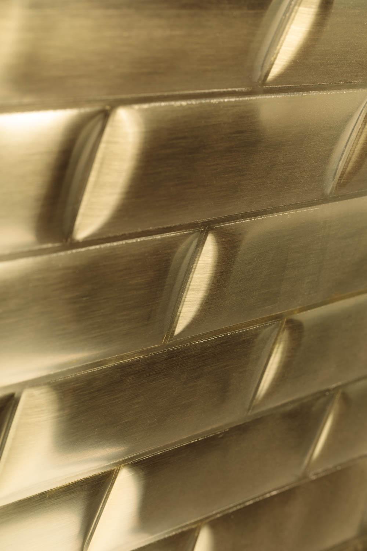 Gold colored aluminum subway tiles