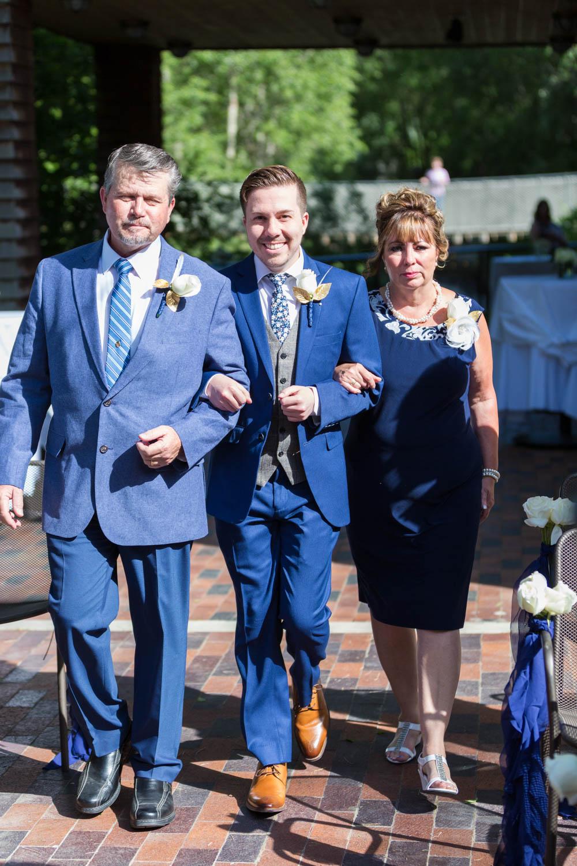 Tyson walks with parents