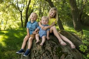 Children sitting on a rock