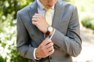 Groom adjusts his watch and cuffs