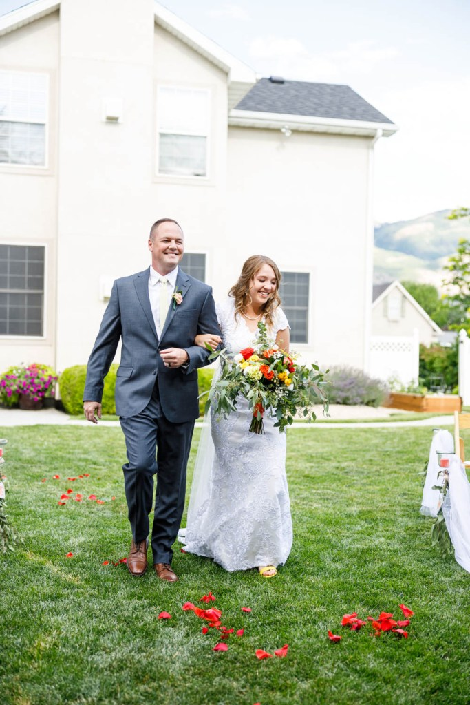 Bride walks the aisle with dad