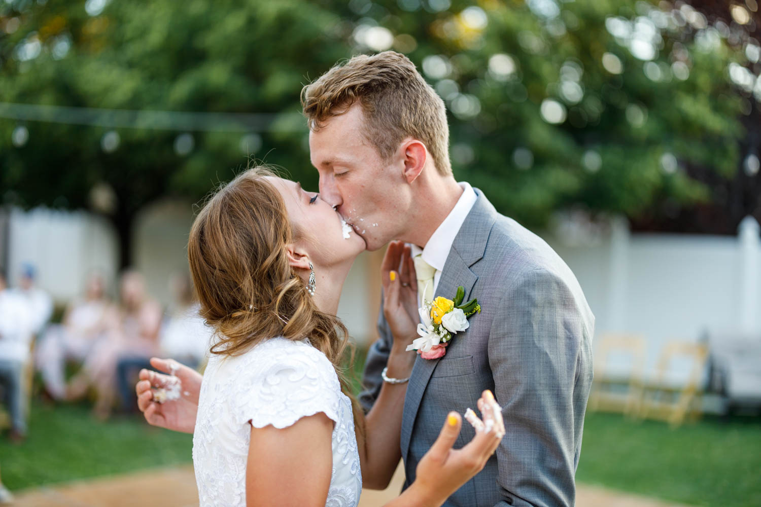 A kiss after the cake smash