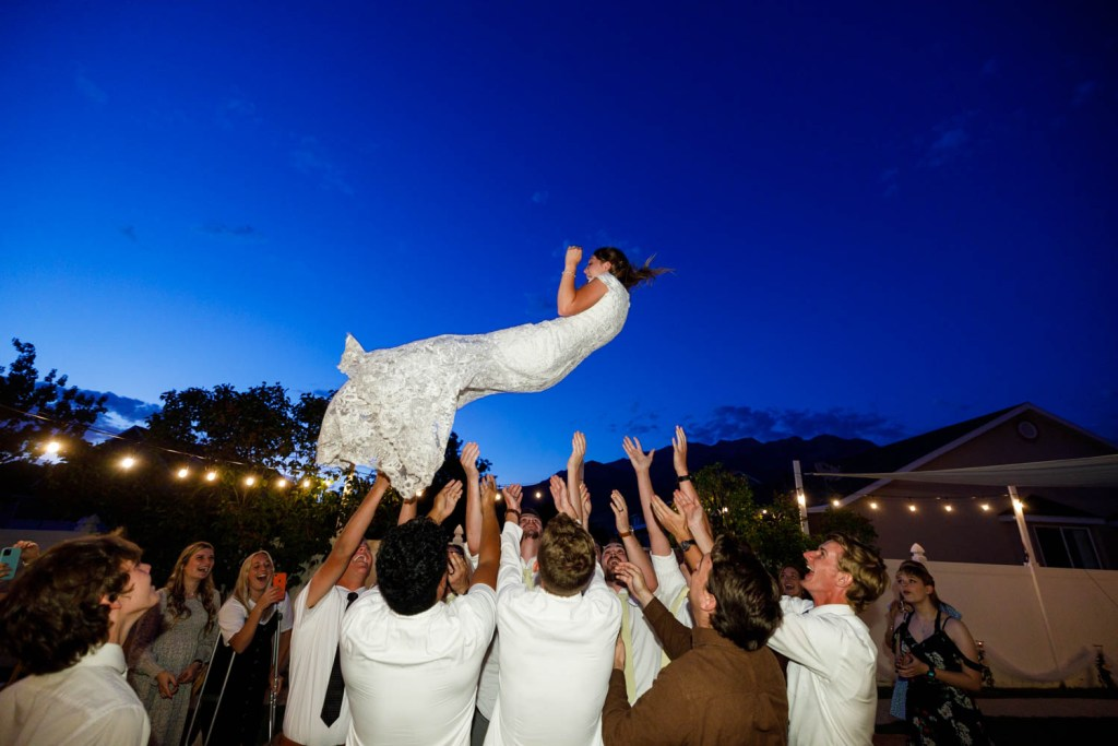 Throwing the bride into the air