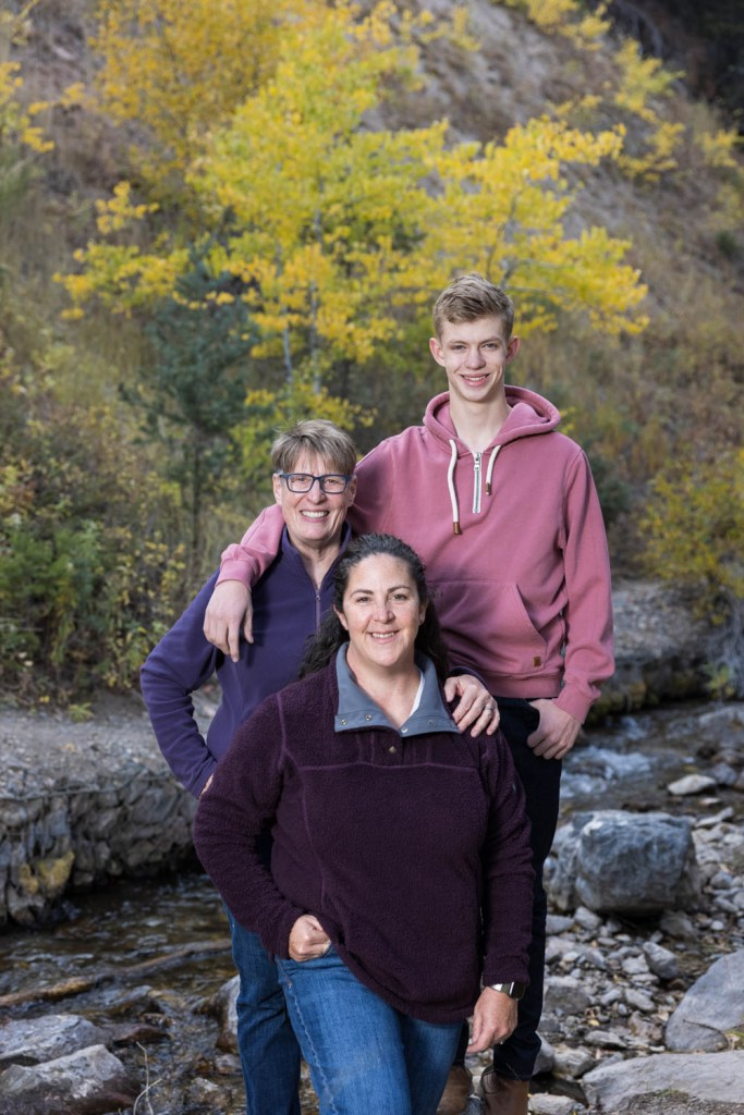 Family portraits by a creek at Tibble Fork Reservoir