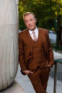 Male portrait in a sharp brown suit