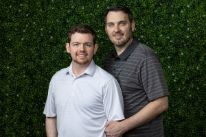 Couple portrait in front of the green wall