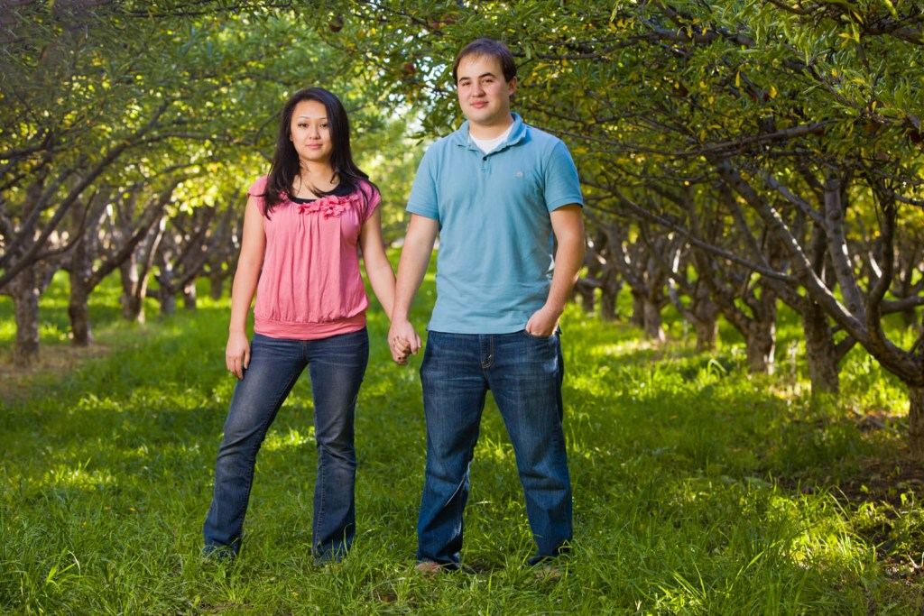 Mom and dad's portrait in an apple orchard
