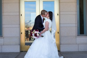 Bride and groom kiss on leaving the temple