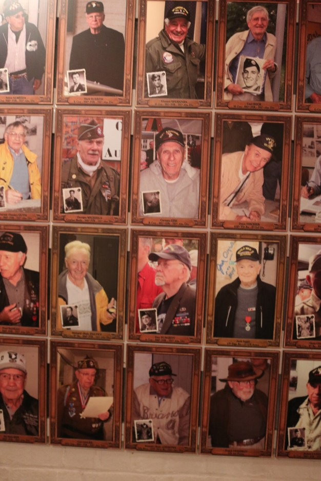 All the WWII veterans who have returned to visit Bastogne, have their pictures hanging in this room. They cover much of the 4 walls!
