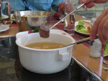 Cooking our meat in the fondue pots.