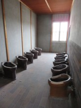 The only toilets for the barrack. (no privacy)