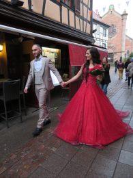Bride and groom walking down the street!