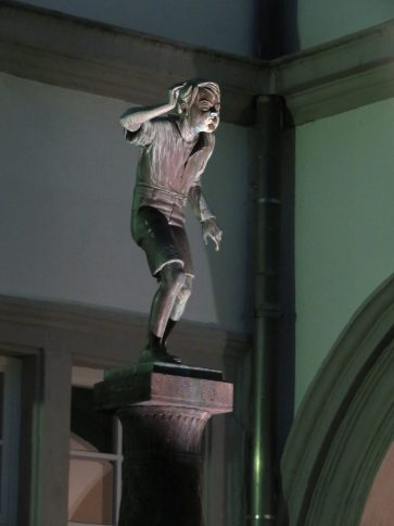 A close up of the boy on the statue.