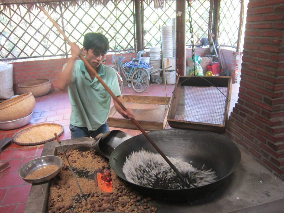 Man making candy in the Mekong Delta, Vietnam