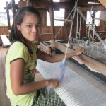 The people of Myanmar - A girl working on Inle Lake