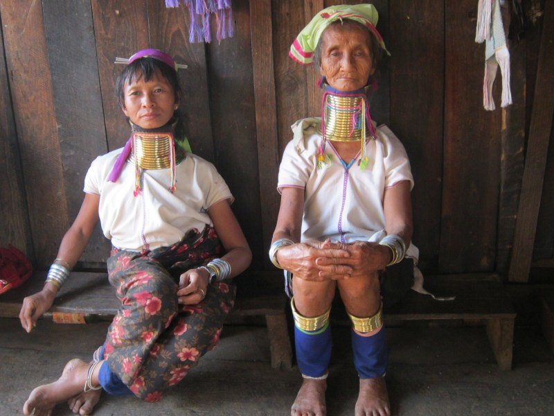 2 ''long-neck' Karreni women sitting down in Kayah State, Myanmar
