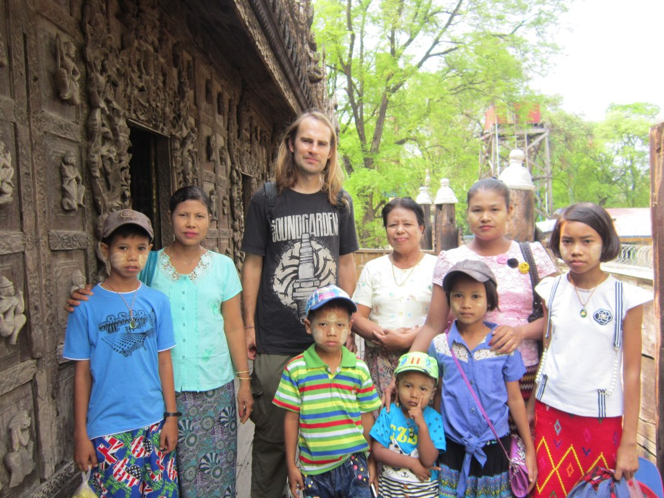 The People Of Myanmar - posing with a family visiting Shwenandaw Monastery in Mandalay. Backpacking tips - don't ignore the locals!
