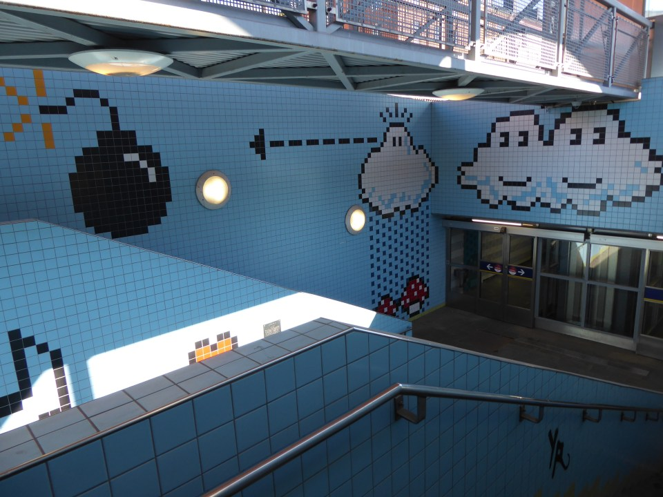 Pixelated artwork at Thorildsplan station in Stockholm. Including clouds and a bomb in style of retro video games.