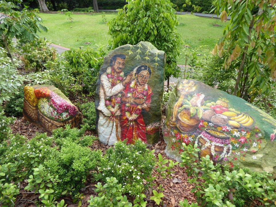 The Botanical Gardens in Singapore - artwork on a stone amongst greenery