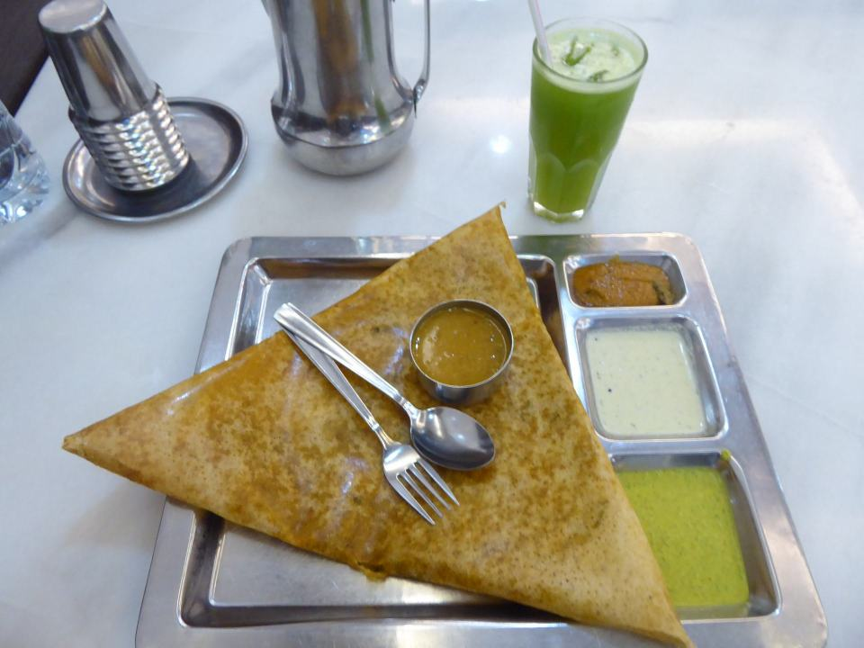 A dosa and curry dips, plus a green juice