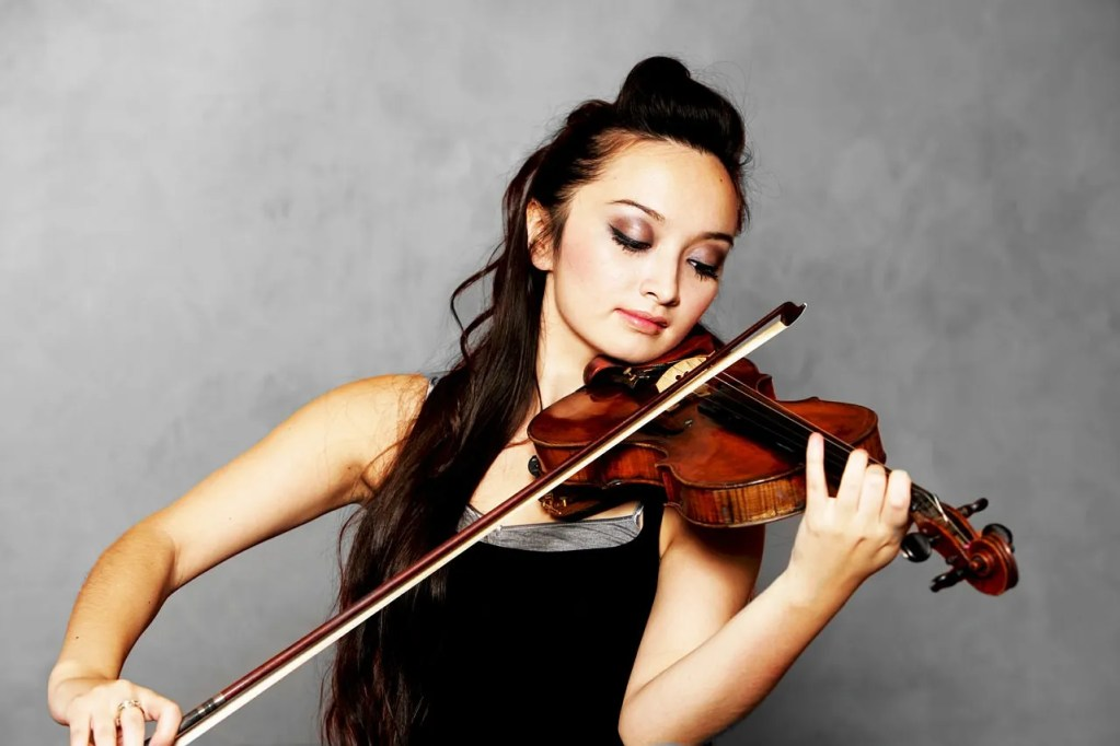 Photo of Woman Playing Violin