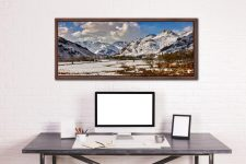The mountains of the Langdale Valley under a coating of snow - Walnut floater frame with acrylic glazing on Wall