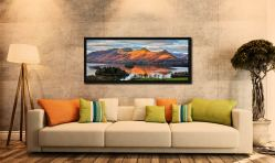 View over Derwent Water to a sunlit Cat Bells - Black oak floater frame with acrylic glazing on Wall