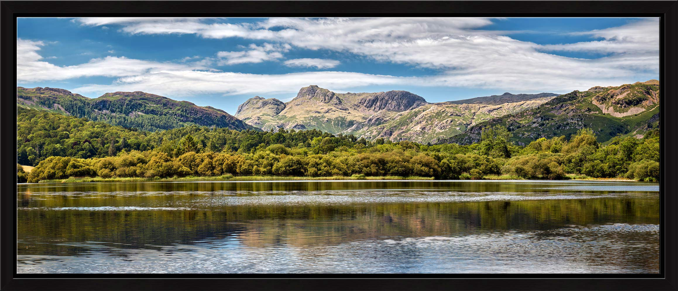Summer view of the Langdale Pikes over Elter Water