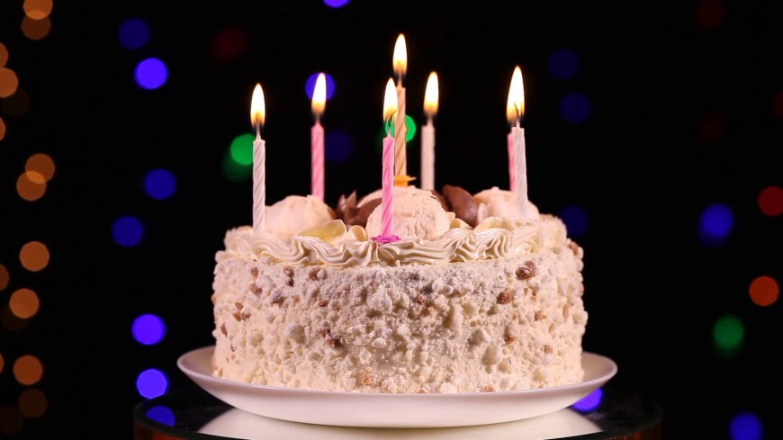 Happy Birthday Cake Pic Happy Birthday Cake With Burning Candles In Front Of Black