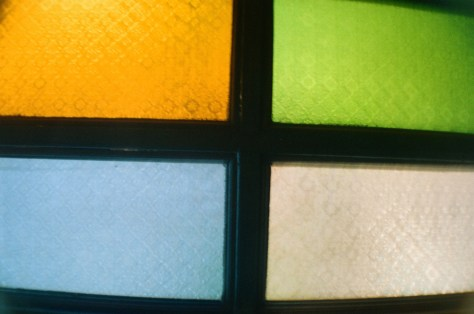 Towns and Trains: light filters in via coloured glass panes