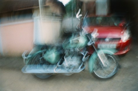 Scenes of Life in Tripunitura & Kochi: classic looking but newly built, Royal Enfield motorcycles are common and striking to behold