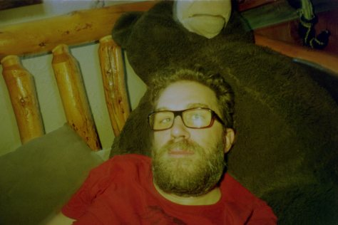 Earthship VW bus/sauna: dave and giant bear in Mangy Moose lodge
