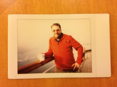 At Sea: Leaning with mug and orange sweater, 1