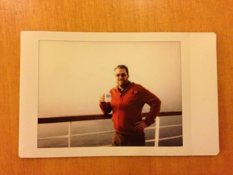 At Sea: Leaning with mug and orange sweater, 3