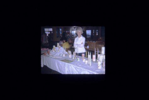 Granny Selling Candles for Bright Idea Company
