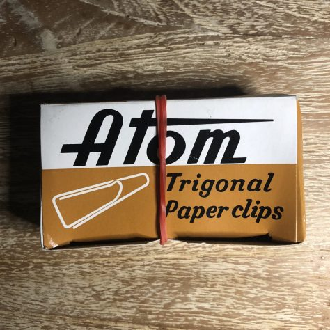 "Items: stationery, paper clips (""Atom"", brown box, trigonal contents - with rubber band)"