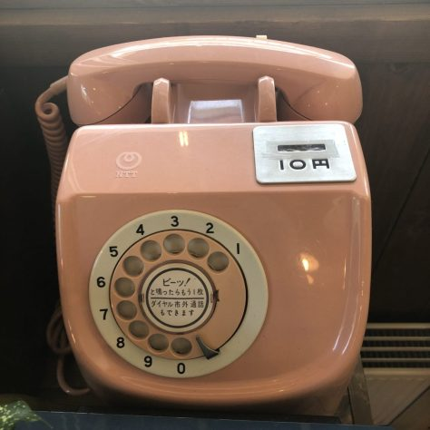 Artifacts: Phone, pink, rotary dial, 10 yen slot (in a coffee shop in Nozawa Onsen)