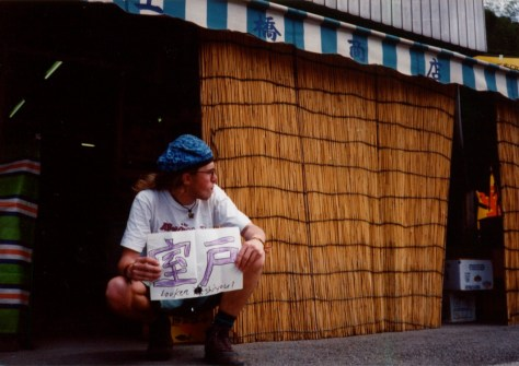 Japan hitch-hiking: holding a sign for Muroto in the southern tip of Shikoku