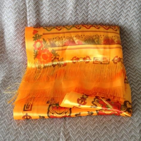 Nepal: orange travel scarf