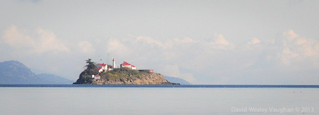 Denman Island 's souther tip (left) and little Chrome Isle (right).