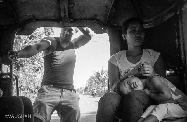 Childproof seating on a Jeepney involves a mother's knee and a prayer.