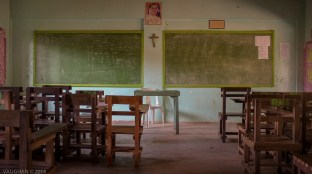 The humble classroom of a Philippine High School. God is clearly promoted as well as chalk and good old green slate. It's as elementary as schooling gets and it seems to produce a very impressive student body still.