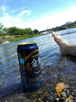 This is my foot in the cool water with my beer