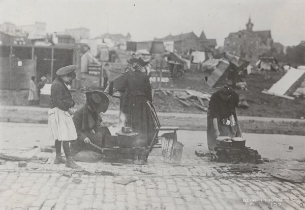 Refugees at street kitchen. Near camp at Market and Buchanan Sts. California State Library, California History Room