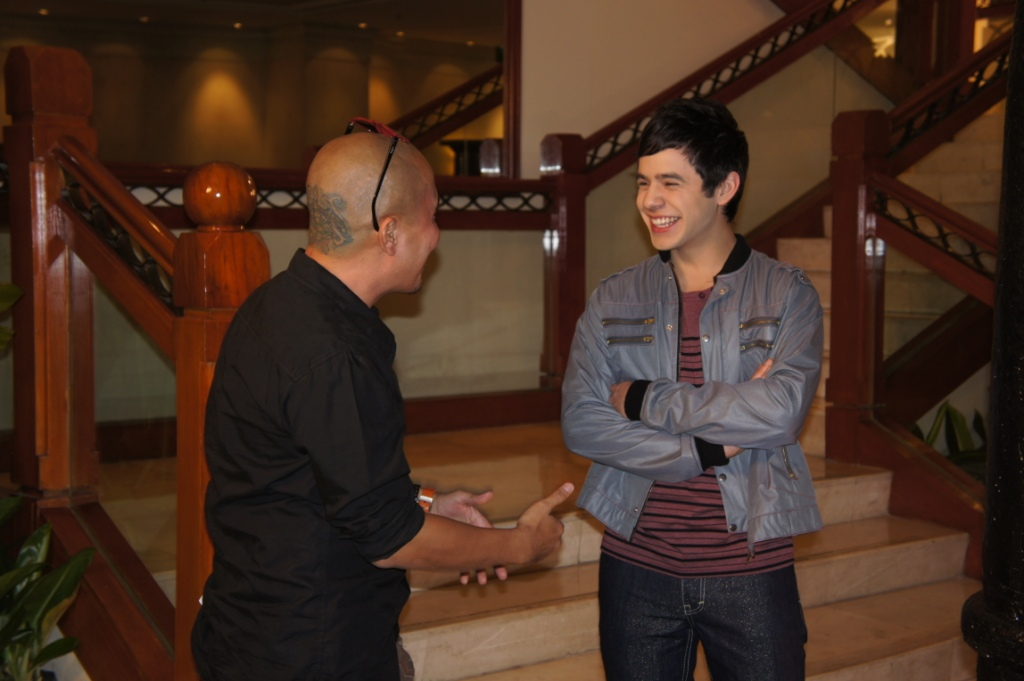David getting direction from Dante Nico Garcia, while shooting promotional trailers,  Philippines, January 2012.