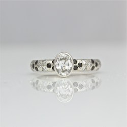 Modern diamond platinum engagement ring