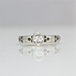 Modern diamond platinum engagement ring